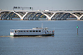 A water taxi originating at National Harbor makes its way along the Potomac River near the Woodrow Wilson Bridge in Oxon Hill, Maryland on Monday, October 12, 2015.<br /> Credit: Ron Sachs / CNP