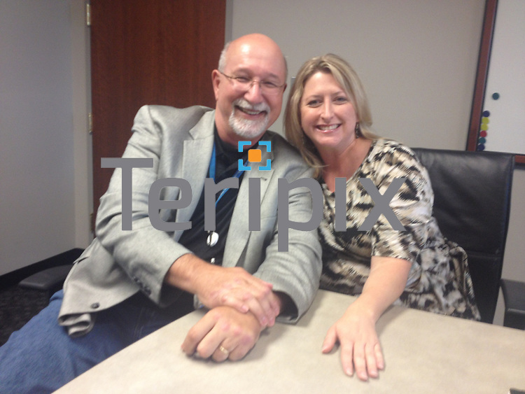 6/27/13 Ted McAfee and Susan Yost pose for a picture during the Eventrapix meeting