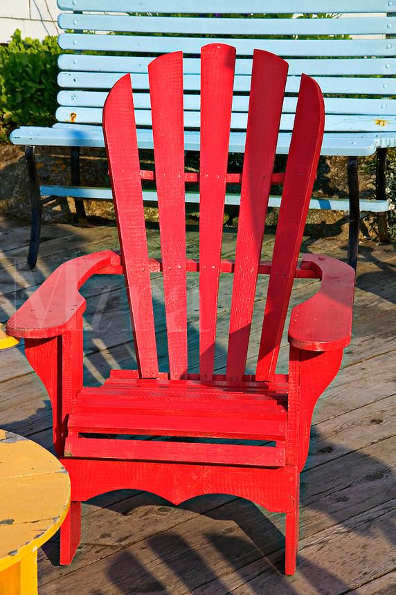 Red wooden deck chair, Peggy's Cove; Nova Scotia; Canada