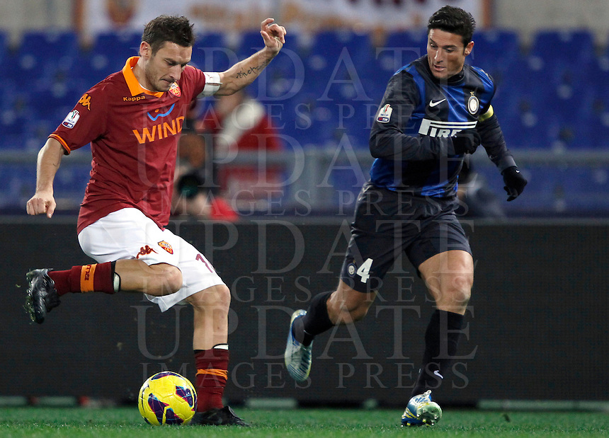 Calcio, semifinale di andata di Coppa Italia: Roma vs Inter. Roma, stadio Olimpico, 23 gennaio 2013..AS Roma forward Francesco Totti, left, is challenged by FC Inter defender Javier Zanetti, of Argentina, during the Italy Cup football semifinal first half match between AS Roma and FC Inter at Rome's Olympic stadium, 23 January 2013..UPDATE IMAGES PRESS/Isabella Bonotto