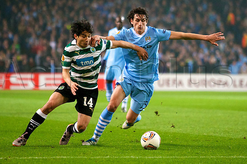 15.03.2012 Manchester, England. Sporting Clube de Portugal Chilean midfielder Matias Fernandez and Manchester City's Montenegro defender Stefan Slavic in action during the UEFA Europa Cup match between Manchester City v Sporting at the Etihad Stadium.