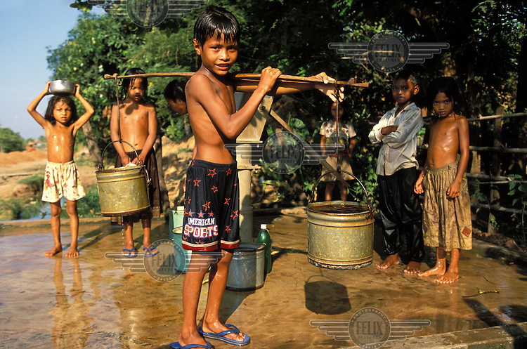 Children gather water from a well.