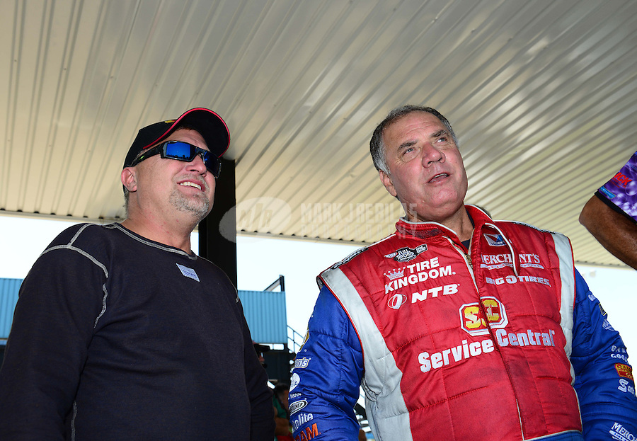 Sept. 22, 2012; Ennis, TX, USA: NHRA funny car driver Jeff Arend (left) with Johnny Gray during qualifying for the Fall Nationals at the Texas Motorplex. Mandatory Credit: Mark J. Rebilas-