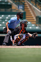 Umpire Kaleb Martin and GCL Orioles catcher Jordan Cannon (35) during a Gulf Coast League game against the GCL Red Sox on July 29, 2019 at Ed Smith Stadium in Sarasota, Florida.  GCL Red Sox defeated the GCL Pirates 9-1.  (Mike Janes/Four Seam Images)