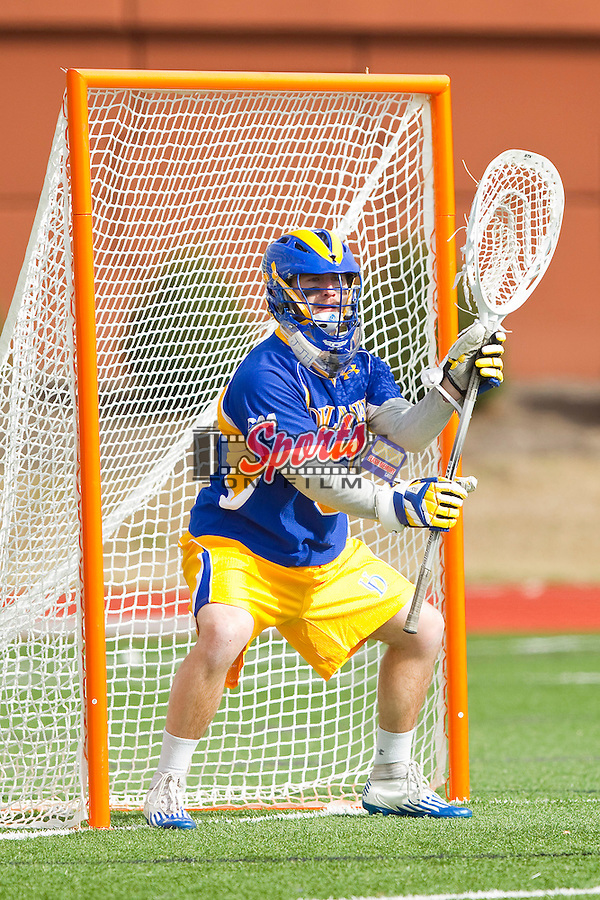Chris Herbert (3) of the Delaware Blue Hens defense his goal during the game against the High Point Panthers at Vert Track, Soccer & Lacrosse Stadium on February 2, 2013 in High Point, North Carolina.  The Blue Hens defeated the Panthers 12-10.   (Brian Westerholt/Sports On Film)