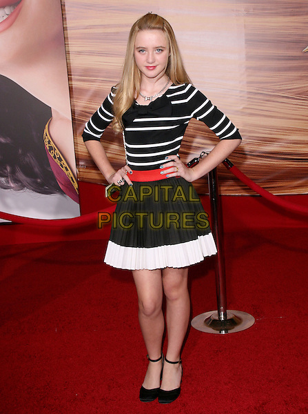 "KATHRYN NEWTON.Disney Premiere of ""Tangled"" held at El Capitan Theatre in Hollywood, California, USA..November 14th, 2010.full length top skirt hands on hips red belt black white stripe.CAP/RKE/DVS.©DVS/RockinExposures/Capital Pictures."