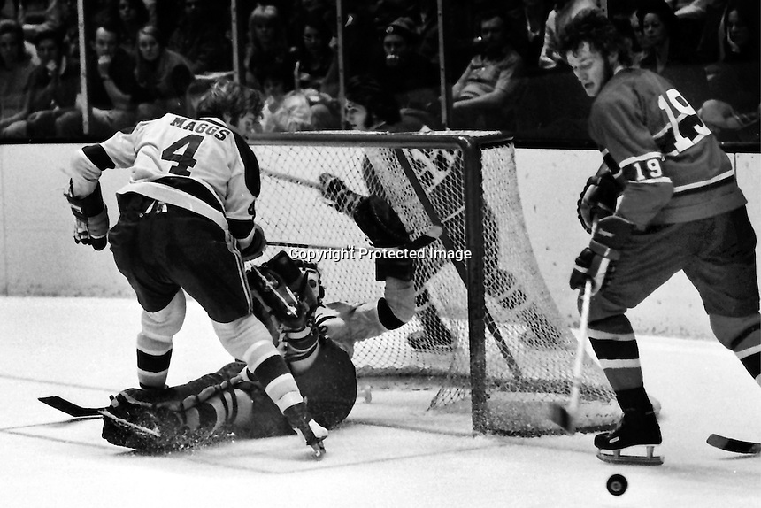 Seals vs Montreal: #19 Larry Robinson in on Darry Maggs and goalie Gilles Meloche. (1973 photo by Ron Riesterer)