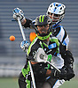 Rob Pannell #3 of the New York Lizards, front, uses his forehand to make a flip pass during a Major League Lacrosse game against the Ohio Machine at Shuart Stadium in Hempstead, NY on Thursday, June 29, 2017.