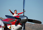 "Robert ""Hoot"" Gibson waves to the crowd from his plane Strega after winning the Unlimited Championship during the National Championship Air Races at the Reno-Stead Airfield Sunday, Sept. 20, 2015."