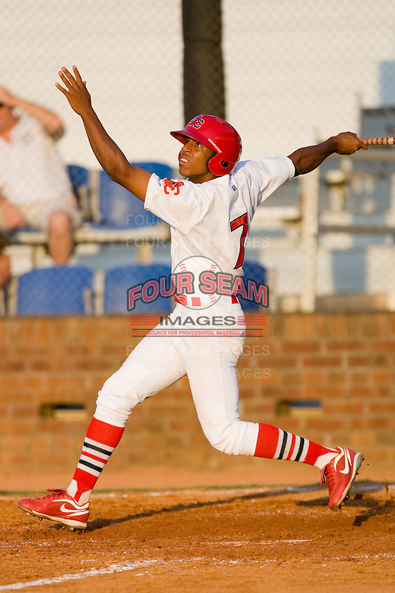 Oscar Taveras #7 of the Johnson City Cardinals follows through on his swing against the Elizabethton Twins at Howard Johnson Field July 3, 2010, in Johnson City, Tennessee.  Photo by Brian Westerholt / Four Seam Images