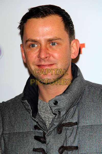 Scott Mills.The launch of the Disney TV Series 'Sofia The First' at the Mayfair Hotel, London, England..22nd February 2013.headshot portrait grey gray.CAP/CJ.©Chris Joseph/Capital Pictures.