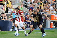 Jesus Padilla (10) of CD Chivas USA is marked by Jordan Harvey (2) of the Philadelphia Union. The Philadelphia Union defeated CD Chivas USA 3-0 during a Major League Soccer (MLS) match at PPL Park in Chester, PA, on September 25, 2010.