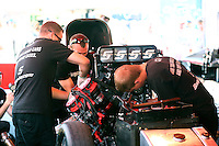 Aug. 3, 2014; Kent, WA, USA; Crew members working on the engine of NHRA funny car driver Cruz Pedregon during the Northwest Nationals at Pacific Raceways. Mandatory Credit: Mark J. Rebilas-