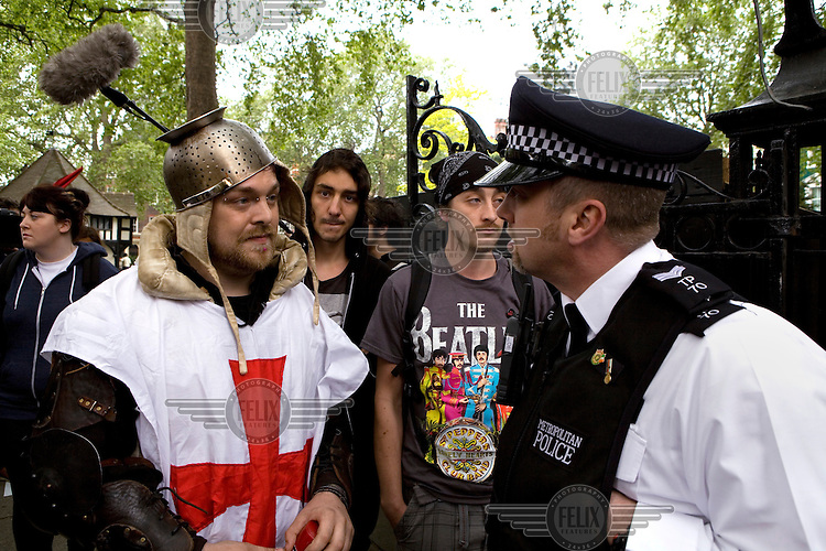 A man dressed as a medieval knight talks to a policeman while celebrating in Trafalgar Square, London during the Royal Wedding between Britain's Prince William and Kate Middleton.