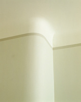 Paint techniques have been used to create a false cornice where the wall would otherwise blend into the ceiling