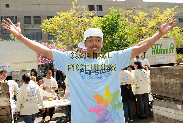 NICK CANNON.PepsiCo & Feeding America Day Of Service At City Harvest, New York, NY, USA..April 20th, 2010.half length arms in air outstretched blue t-shirt white baseball cap hat goatee facial hair .CAP/ADM/BM.©Bill Menzel/AdMedia/Capital Pictures.