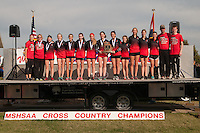 THe Jackson Lady Indians stand atop the awards stage with their first-place Class 4 trophy at the state cross country championships in Jefferson City, Saturday, November 5.
