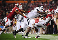 Jan. 1, 2011; Glendale, AZ, USA; Oklahoma Sooners wide receiver (85) Ryan Broyles is tackled by Connecticut Huskies linebacker (8) Lawrence Wilson in the 2011 Fiesta Bowl at University of Phoenix Stadium. The Sooners defeated the Huskies 48-20. Mandatory Credit: Mark J. Rebilas-.