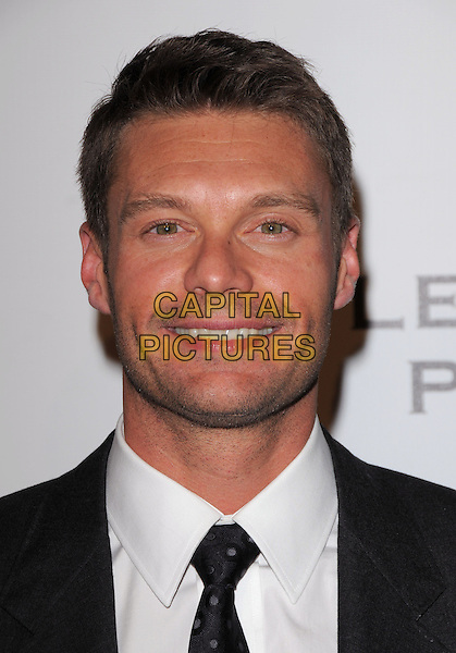 RYAN SEACREST .at The Fulfillment Fund Annual Stars 2008 Benefit Gala held at The Beverly Hilton Hotel in Hollywood, California, USA, October 13th 2008.                                                                     .portrait headshot black tie smiling stubble tie.CAP/DVS.©Debbie VanStory/Capital Pictures