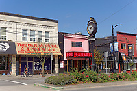 Historic buildings and Mount Pleasant welcome clock on Main Street in the Mount Pleasant district of Vancouver, BC, Canada