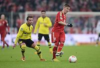 FUSSBALL  DFB-POKAL  VIERTELFINALE  SAISON 2012/2013    FC Bayern Muenchen - Borussia Dortmund          27.02.2013 Mario Goetze (li, Borussia Dortmund) gegen Bastian Schweinsteiger (re, FC Bayern Muenchen)
