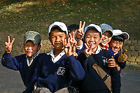 """Vietnamese Kids posing with that ubiquitous """"V"""" sign that seems to be obligatory in any photo session in Asia..."""
