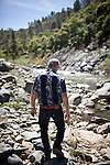 Gold miner James Butler walks on his mining claim along Deer Creek in the Sierra foothills near Smartsville, California, April 19, 2012..CREDIT: Max Whittaker/Prime for The Wall Street Journal.MINER