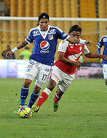 BOGOTA - COLOMBIA -21-09-2013: Gerardo Bedoya (Der.) jugador de Independiente Santa Fe disputa el balón con Dayro Moreno (Izq.) jugador de Millonarios durante del partido en el estadio Nemesio Camacho El campin de la ciudad de Bogota, septiembre 20 de 2013. Independiente Santa Fe y Milonarios en juego por la fecha 10 de la Liga Postobon II. (Foto: VizzorImage / Luis Ramirez/ Staff.) Gerardo Bedoya (R) player of Independiente Santa Fe vies for the ball with Dayro Moreno (L) of Millonarios during a match at the Nemesio Camacho El Campin Stadium in Bogota city, on September 20, 2013. Independiente Santa Fe and Millonarios in a game for the tenth date of the Postobon Leaguje II. (Photo VizzorImage /Luis Ramirez/ Staff.)
