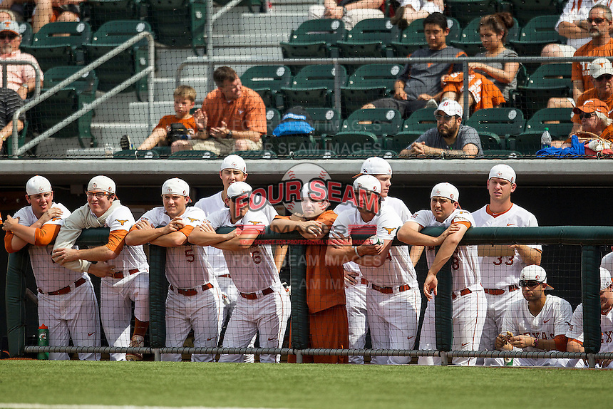 Texas Longhorns bench wearing rally caps during the ninth inning of the NCAA baseball game against the Oklahoma State Cowboys on April 26, 2014 at UFCU Disch–Falk Field in Austin, Texas. The Cowboys defeated the Longhorns 2-1. (Andrew Woolley/Four Seam Images)