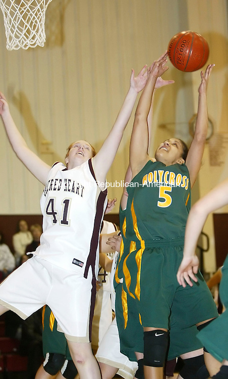 WATERBURY, CT, 02/15/07- 021507BZ09- Holy Cross's Brittany Wilkes (5) hauls down the rebound against Sacred Heart's Sarah O'Brien (41)  <br /> during their game at Sacred Heart Thursday night.<br /> Jamison C. Bazinet Republican-American