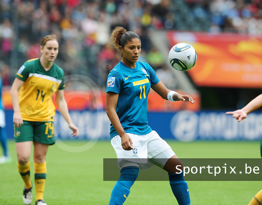 Fifa Women's World Cup Germany 2011 : Brazil - Australia  at Borussia - Park in Munchengladbach : Cristiane aan de bal voor Collette McCallum.foto DAVID CATRY / Vrouwenteam.be