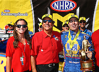 Jun 12, 2016; Englishtown, NJ, USA; NHRA funny car driver Ron Capps (right) celebrates with team owner Don Schumacher (center) and daughter Megan Schumacher after winning the Summernationals at Old Bridge Township Raceway Park. Mandatory Credit: Mark J. Rebilas-USA TODAY Sports
