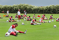 May 20, 2009; Tempe, AZ, USA; Arizona Cardinals wide receiver Larry Fitzgerald (left) stretches during organized team activities at the Cardinals practice facility. Mandatory Credit: Mark J. Rebilas-