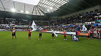 Children form a guard of honour before the Barclays Premier League match between Swansea City and Bournemouth at the Liberty Stadium, Swansea on November 21 2015