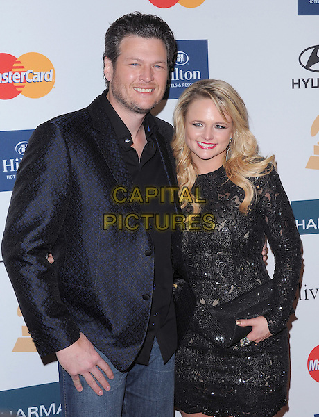 Blake Shelton & Miranda Lambert.attends the Annual Clive Davis & The Recording Company Pre-Grammy Gala held at The Beverly Hilton in Beverly Hills, California, USA, .February 11th 2011..grammys party  half length black jacket blue navy blazer shirt dress  lace clutch bag long sleeve .CAP/RKE/DVS.©DVS/RockinExposures/Capital Pictures.