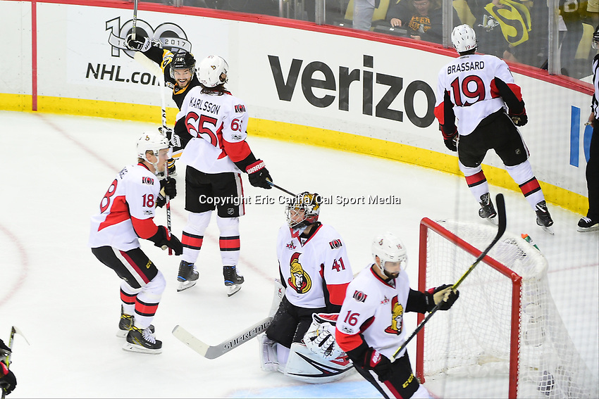 May 25, 2017: Pittsburgh Penguins left wing Chris Kunitz (14) reacts to a goal against Ottawa Senators goalie Craig Anderson (41) during game seven of the National Hockey League Eastern Conference Finals between the Ottawa Senators and the Pittsburgh Penguins, held at PPG Paints Arena, in Pittsburgh, PA. The Pittsburgh Penguins defeat the Ottawa Senators 3-2 in double overtime to win the NHL Eastern Conference Championship and advance to face the Nashville Predators in the Stanley Cup Finals.  Eric Canha/CSM
