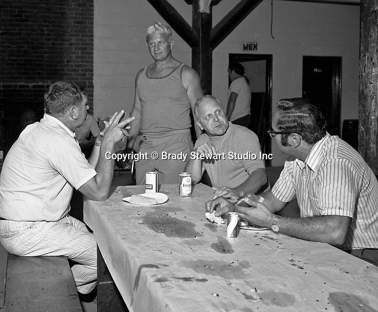 Bethel Park PA:  View of head fooball coach Rudy Andabaker talking with Jim Hannigan, Big Jim Westhoff and Joe Nicoletti during the annual Bethel Park Athletic Association picnic at Lyons Park.  <br /> The picnic gave the Bethel Park boosters a chance to meet the football team and coaches - 1973