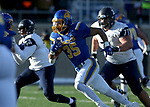 BROOKINGS, SD - DECEMBER 9: Isaac Wallace #35 from South Dakota State University scampers past Ryan Sosnak #71 from the University of New Hampshire for a touchdown during their FCS quarterfinal game Saturday afternoon at Dana J. Dykhouse Stadium in Brookings, SD. (Photo by Dave Eggen/Inertia)