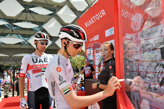 White Jersey Tadej Pogacar (SLO) UAE Team Emirates at sign on before Stage 5 the Al Ain Water Stage of the UAE Tour 2020 running 162km from Al Ain to Jebel Hafeet, Dubai. 27th February 2020.<br /> Picture: LaPresse/Massimo Paolone | Cyclefile<br /> <br /> All photos usage must carry mandatory copyright credit (© Cyclefile | LaPresse/Massimo Paolone)