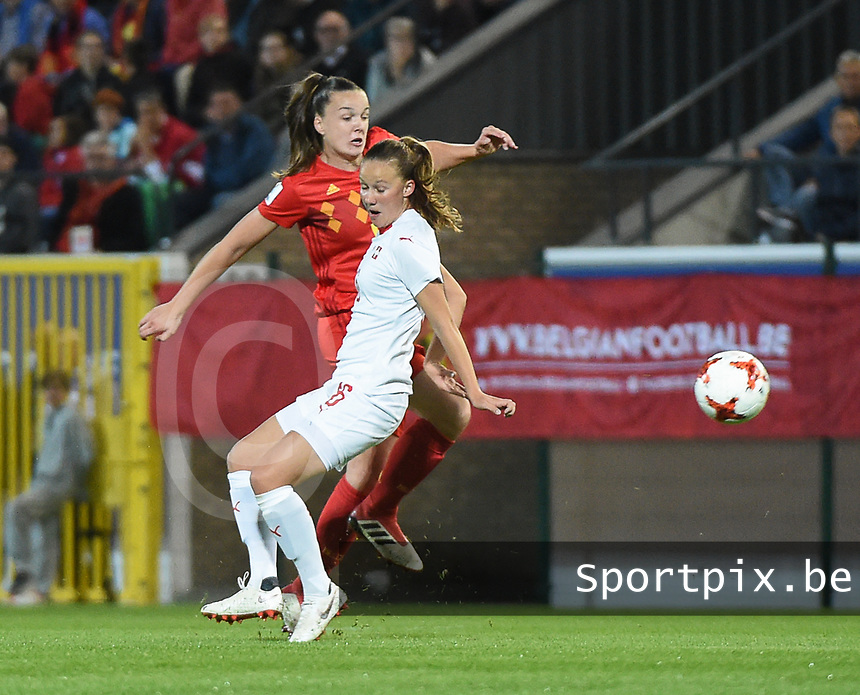 20181005 - LEUVEN , BELGIUM : Belgian Tine De Caigny (L) and Switzerland's Geraldine Reuteler (R)  pictured during the female soccer game between the Belgian Red Flames and Switzerland , the first leg in the semi finals play offs for qualification for the World Championship in France 2019, Friday 5 th october 2018 at OHL Stadion Den Dreef in Leuven , Belgium. PHOTO SPORTPIX.BE | DIRK VUYLSTEKE
