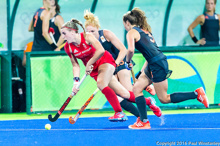 Lily Owsley #26 of Great Britain is chased by Xan de Waard #3 of Netherlands and Caia van Maasakker #13 of Netherlands during Netherlands vs Great Britain in the gold medal final at the Rio 2016 Olympics at the Olympic Hockey Centre in Rio de Janeiro, Brazil.