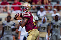 TALLAHASSEE, FLA 9/10/16-Florida State quarterback Deondre Francois looks for a receiver during third quarter action against Charleston Southern, Saturday at Doak Campbell Stadium in Tallahassee. <br /> COLIN HACKLEY PHOTO