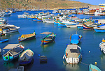 Colourful fishing boats in the harbour at port of Mgarr, island of Gozo, Malta