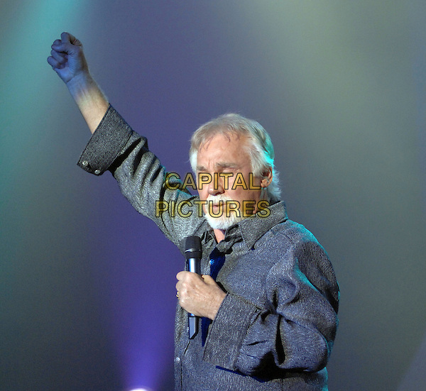 KENNY ROGERS.Performs live at the Alabama Theatre, Myrtle Beach, South Carolina, USA..July 12th, 2007.half length stage concert gig performance music singing grey gray suit goatee facial hair arm in air .CAP/ADM/MO.© Moose/AdMedia/Capital Pictures