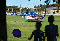 NWA Democrat-Gazette/BEN GOFF @NWABENGOFF<br /> Children watch as the Air Evac Lifeteam helicopter lands on Saturday Sept. 12, 2015 during the Northwest Arkansas Emergency Preparedness Fair at the Church of Jesus Christ of Latter-Day Saints in Bentonville. The event included a variety of informational booths, a blood drive, games for children, appearances by emergency vehicles and meteorology classes to help families be prepared for emergencies.