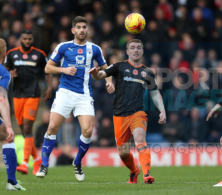 John Fleck of Sheffield Utd gets in front of Ched Evans of Chesterfield during the English League One match at the Proact Stadium, Chesterfield. Picture date: November 13th, 2016. Pic Simon Bellis/Sportimage