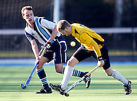 Kieran Roche (L) in action for Hampstead during the EHL Mens Cup Quarter-Final game between Hampstead and Westminster and Old Loughtonians at the Paddington Recreation Ground, Maida Vale on Sun Mar 7, 2010