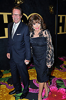 LOS ANGELES, CA. September 17, 2018: Joan Collins & Percy Gibson at The HBO Emmy Party at the Pacific Design Centre.<br /> Picture: Paul Smith/Featureflash