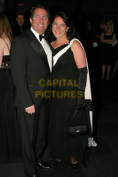 DR. LIAM FOX MP & JESME BAIRD.Conservative Party Black & White Ball at Old Billingsgate Market, London, UK..February 8th, 2006.Ref: AH.full length tuxedo dress.www.capitalpictures.com.sales@capitalpictures.com.© Capital Pictures.