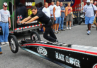 Oct 6, 2013; Mohnton, PA, USA; Crew member Gary Pritchett moves the front of the car of NHRA top fuel dragster driver Steve Torrence during the Auto Plus Nationals at Maple Grove Raceway. Mandatory Credit: Mark J. Rebilas-
